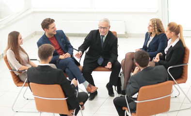 Businessman Leading Meeting At Boardroom