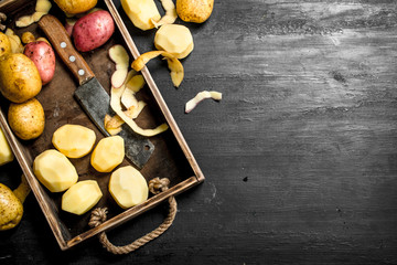 Fresh potatoes on a tray.