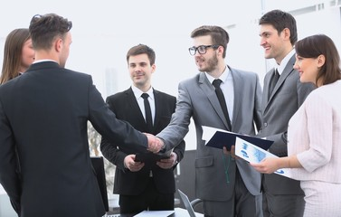 handshake of business partners before the financial transaction