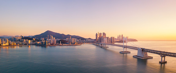 Gwangan Bridge and Haeundae aerial view at Sunrise, Busan, South Korea. Wall mural