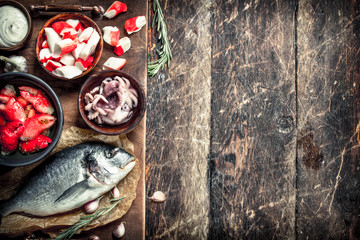 Fototapete - Delicious seafood on the board.