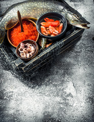 Fototapete - Different seafood in the box.