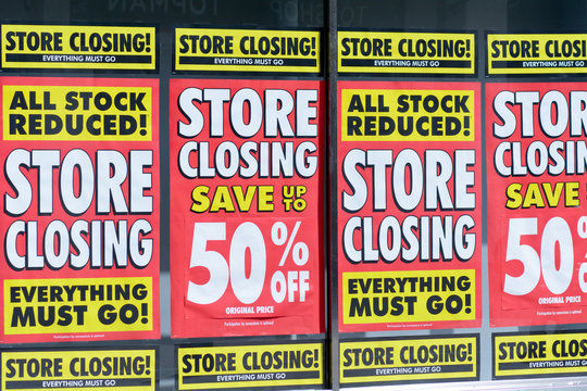 Store Closing signs shop window in Bedford, Bedfordshire, England