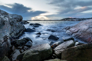 Small bay in Helleviga recreation area, rocks and stones in the ocean, blue hour in South Norway