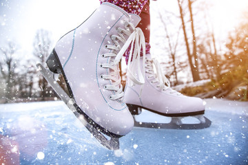 Close-up of woman ice skating on a pond.