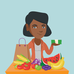 Young african woman standing near the table with shopping bag, grocery purchases and holding money. Woman with money and grocery purchases after shopping. Vector cartoon illustration. Square layout.