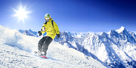 winter skier and mountains landscape