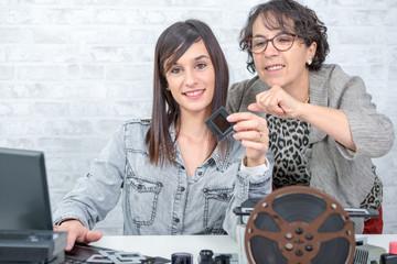 two women looking at film slide