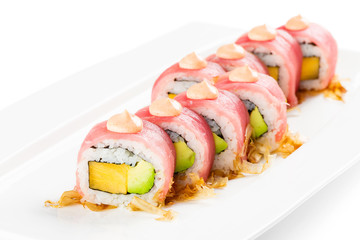 Tuna urumaki sushi roll with avocado and persimmon