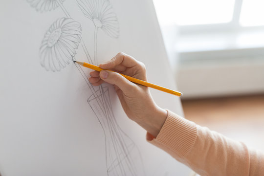 artist with pencil drawing picture at art studio