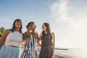 group of three young woman walking in vacation