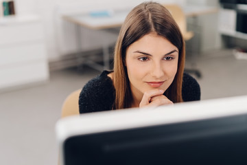 Natural young businesswoman sitting working