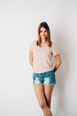 Portrait of a fit young woman wearing short jeans