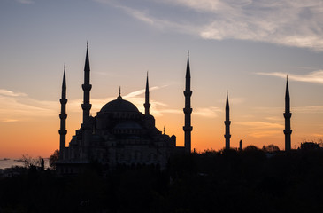 Silhouette of Blue mosque Sultan Ahmed on sunset background in Istanbul, Turkey