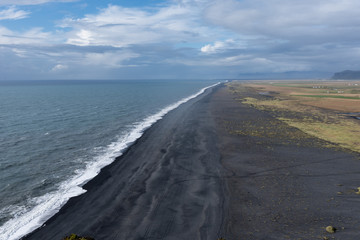 Black sand beach from the cliffs