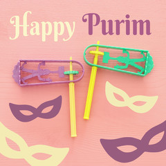 Purim celebration concept (jewish carnival holiday). Top view of noise maker traditional toy.
