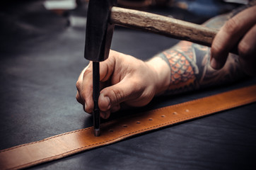 Wizard leather punches holes in the men's belt