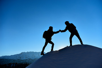 female mountaineer help hand
