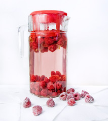 raspberry in a glass jug