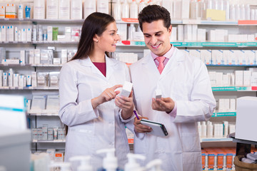 pharmacists  posing in drugstore