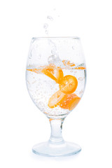Citrus fruit slices into drinking glass isolated with clipping path