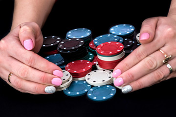 grate hands and poker chips on the table