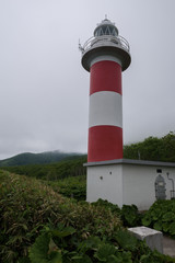 Idyllic lighthouse on top of a rocky cliff on the Shiretoko Peninsula, Hokkaido, Japan