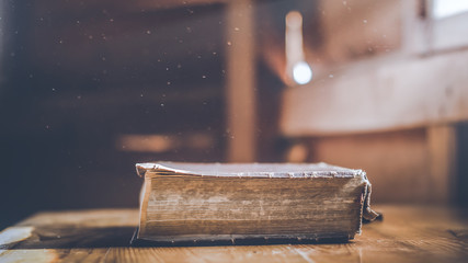 Old holy Bible on wooden table