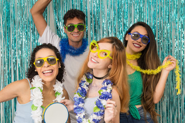 Partygoers are celebrating Carnival in Brazil. People in colorful and happy sunglasses..
