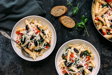 Sauteed cherry tomatoes and spinach pasta