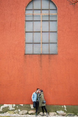 A couple kissing at the wall