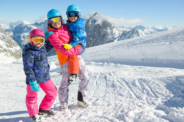 Happy family enjoying winter vacations in mountains . Ski, Sun, Snow und fun.