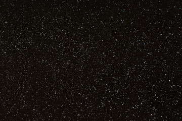 Abstract winter night background - snowflakes on a dark sky