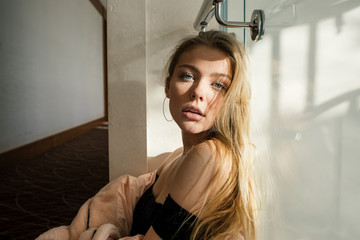 Bewitching blonde woman looks seductively at the camera