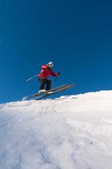 Male skier free ridning downhill ski slope