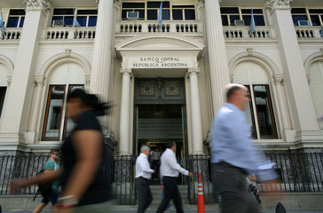 Pedestrians pass by Argentina's Banco Central (Central Bank) in Buenos Aires' financial district