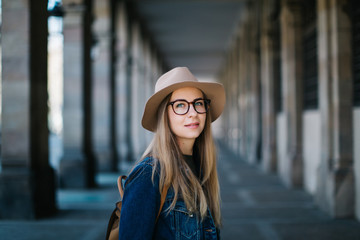 portrait of woman with glasses and hat