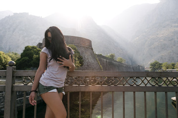 A girl on the background of a fortress in Kotor, shows an engagement ring