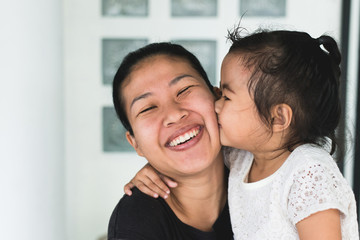 Asian woman holding kid