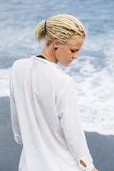 Woman on black sand beach