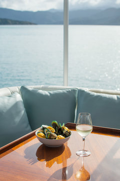 Luxury boat dining with wine and mussels