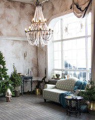 apartments with decorated Christmas tree, sofa, large windows
