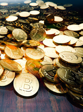 Bitcoin boom, pile of golden coins scattered on table