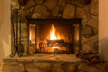 Intimate fire in a stone fireplace