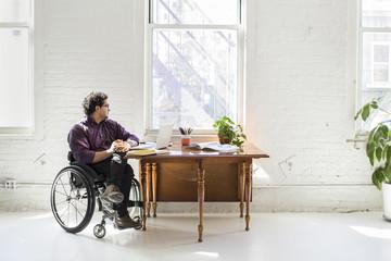 Man sitting by a window