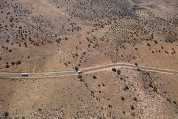 The road winds through the desert at the Grand Canyon