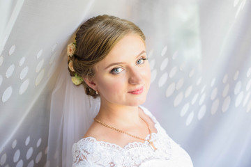 Beautiful bride portrait with veil over her face. portrait of young gorgeous bride. Wedding.