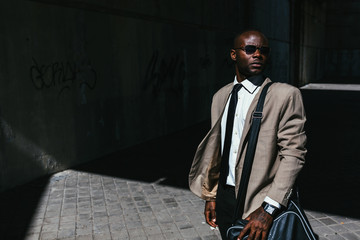 Young businessman walking in the street