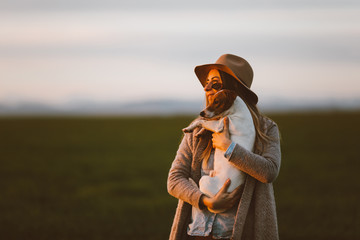happy woman with his dog at sunset