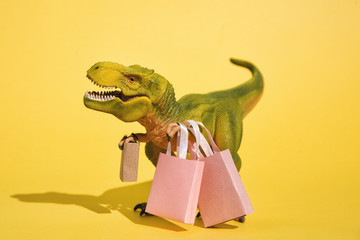 Toy T-Rex with shopping bags